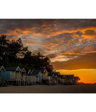 Sunset Over Wells Beach Huts Greetings Card